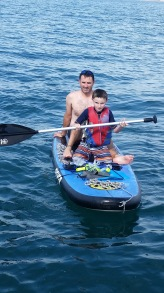 Elliott & Daddy paddling while we anchored at Isla Venderas