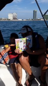 Tennille reading to Finley on our voyage back to the marina